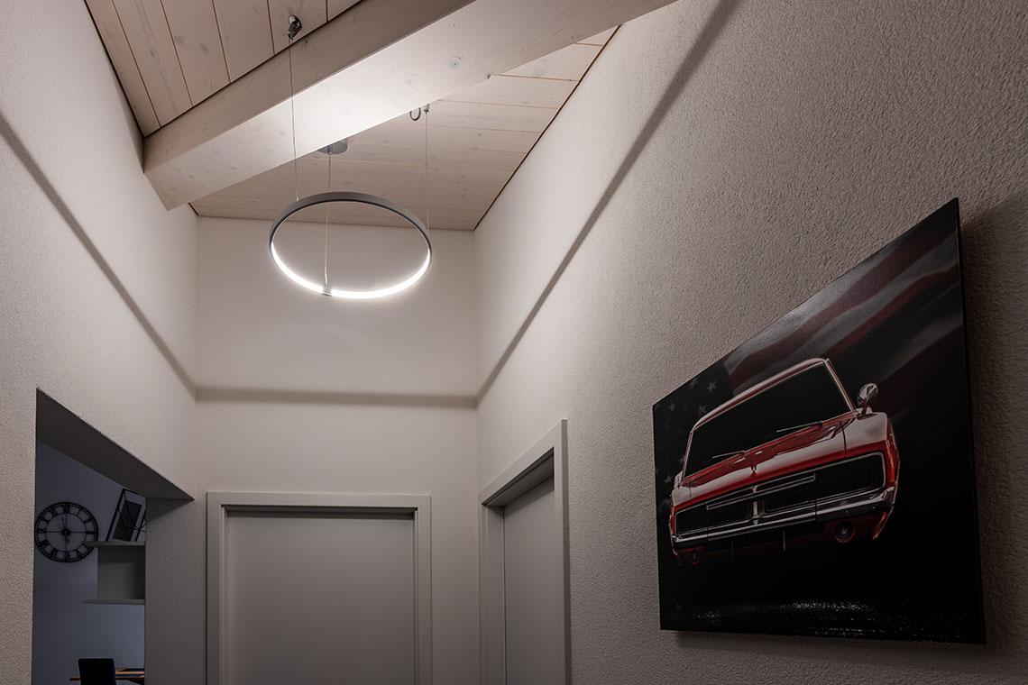 luminaire circulaire rond design pour un appartement privé à Fribourg